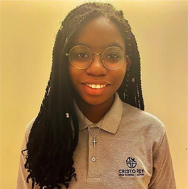 Head and shoulders picture of MathWorks work-study student Chanelle. She is wearing her Cristo Rey uniform and a big smile.