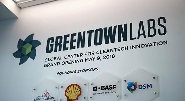 "Sign reading ""Greentown Labs. Global Center for Cleantech Innovation. Grand Opening May 9, 2018."" Plaques for founding sponsors under sign."